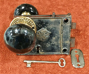 Antique Rim Russwin & Erwin Lock Set with Key, Knob Ring, and Black Marble Knobs
