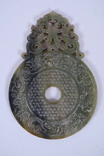 Antique Chinese mottled green hardstone pi-disc with carved dragon decoration.