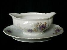 Saucière en porcelaine de Limoges décor floral violet vers 1900