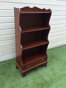 ANTIQUE MAHOGANY BOOKCASE WATERFALL SIDED WITH DRAWER
