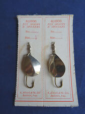 A PAIR OF VINTAGE ALLCOCKS HOGBACK FLY SPOONS ON ORIGINAL CARDS