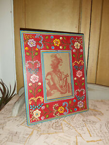 INDIAN HAND PAINTED WOODEN STANDING PHOTO FRAME WITH A RED BACKGROUND