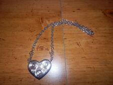 RECORD HEART NECKLACE WITH MUSIC NOTES ON EACH SIDE OF HEART FROM HOT TOPIC