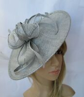 NEW SILVER GREY SINAMAY & FEATHER FASCINATOR .Shaped saucer disc,Wedding.