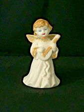 "White Bisque Angle Bell Accented In Gold Playing An Instrument 5"" Tall"