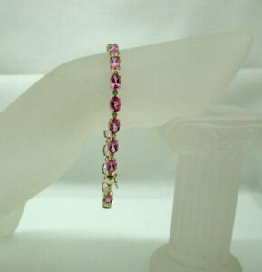 Beautiful 9 carat Gold Pink And White Topaz Line Bracelet