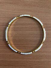Golden alloy white plastic beads bracelet