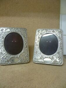 A VINTAGE PAIR OF REPOUSSE PATTERNED FREE STANDING, SILVER PLATED  PHOTO FRAMES
