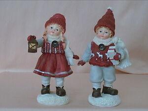 2 ganz niedliche Winterkinder, Polyresin, 14-15cm, neu