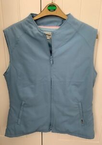 Sleeveless Gillet with double end zipper. LPGA. Size M. 100% polyester.