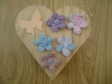 5 pink, purple and blue knitted flowers
