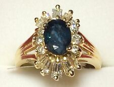 Lady 14kt yellow gold diamond cocktail ring with genuine oval blue sapphire