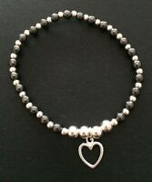 Sterling Silver And Hematite Beaded Stretch Bracelet With Silver Heart Charm.