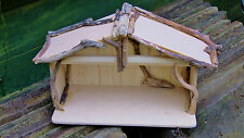 Christmas Nativity shelter stable for baby Jesus with driftwood dercoration