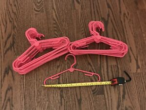 "Set of 30 Pink 12"" Plastic Hangers from Container Store children's closet size"