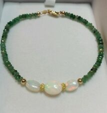 Ethiopian fire opal 6mm oval nuggets and 7cts Emeralds gold 14k bracelet