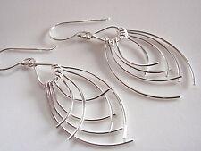 Opposing Curved Dangle Earrings 925 Sterling Silver Corona Sun New