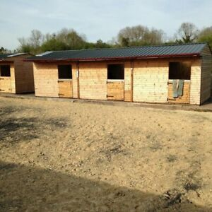 Block of 3 wooden stables