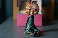 """An original one-of-a-kind, """"Berry Roll"""" polymer clay sculpture."""