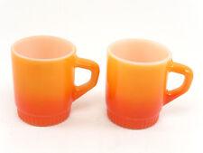 2 Fire King cups orange