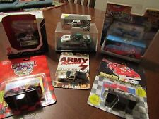 Lot of 6 Nascar 1:64th scale cars new in package one 1:32nd in case