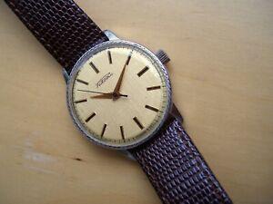 Raketa Vintage Soviet mechanical watch, textured gold colour dial