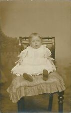 Blackpool. Young child in chair by  Promenade Studio.   JE.1686