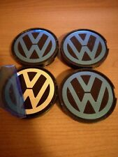 4 tappi COPRIMOZZO FREGI LOGO VW VOLKSWAGEN 55MM GOLF POLO New Beetle