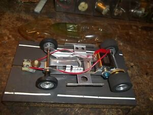VINTAGE REVELL VERY NICE SLOTCAR  NICE  NEW CHASSISPARTS