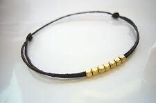 Bracelet cordon double noeuds coulissant perles cube Or