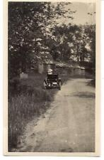 Back View Edwardian Hat Woman Waits In Antique Car Country Road Old House Photo