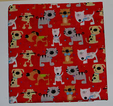 metre in polycotton with fun cats and dogs in bright colours on red