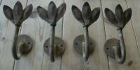 Early to mid 20th century iron petal wall hangings/hooks