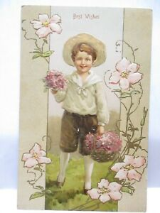 1910 POSTCARD BEST WISHES, BOY IN STRAW HAT WITH BASKET OF FLOWERS