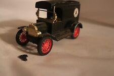 The Ertl Co Diecast Replica 1913 Ford Model T Van Bank w/Key