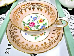 GROSVENOR tea cup and saucer peach color gold gilt teacup England 1940s