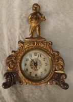 gorgeous Waterbury 1891 mantle clock with porcelain face and cherb on top! 6""