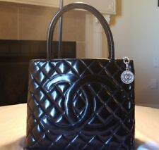 Chanel CC logos  Quilted Paten Leather Medallion Tote Black w/ silver medallion.