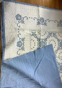 Vintage blue & white hand embroidered quilt 65 x 93 hand quilted blue roses