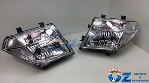 NISSAN PATHFINDER R51 Head lights Headlamps NEW PAIR left & right 2005 - 2007