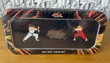 More details for rare street fighter pin set in tin new sealed ryu ,ken & logo set  by koyo