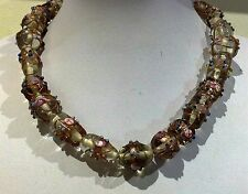 Necklace 44cm Large multi shaped Foil beads. lear and gold. Raised floral patter