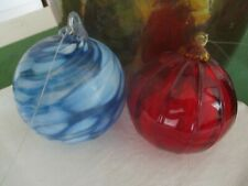 Decorative Two beautiful glass balls,  hand blown? Red and one is blue.