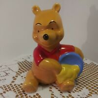 Vintage Walt Disney Winnie the Pooh Bear With Honey Pot Ceramic Figurine.
