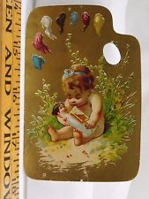 Victorian Die-Cut Painter Pallet Adorable Cherub With Doll & Champagne Glass F37