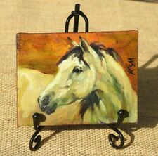 Hand painted miniature oil painting of a white horse, with metal display easel