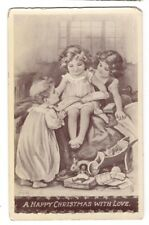OC1920 VINTAGE TUCK CHRISTMAS POSTCARD CHILDREN READING BOOK WITH TOYS C 81