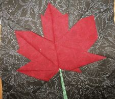 4 Paper Pieced Red Maple Leaf on black background quilt block