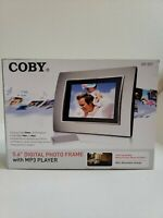 """Coby 5.6"""" Digital Photo Frame with MP3 Player DP-557 ,( Open Box ) , New"""