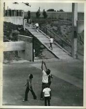"""1970 Press Photo Lower playground open, but kids go up to forbidden closed"""" area"""